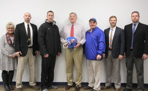 Hall of Fame Coach Mike Rude, center, will return as head coach of Vienna-Goreville football. Pictured from left, are Goreville rincipal Jeri Miller, Goreville superintendent Steve Webb, Goreville athletic director Todd Tripp, Rude, Vienna athletic director David Hill, Vienna superintendent Joshua Stafford and Vienna principal John Giffin.